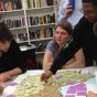 BAED students talk over a regional map during studio.