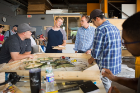 Team Walter P. Moore huddles in a prototyping session in the fabrication shop in Parker Hall. Photo by Douglas Levere