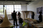 By assembling a series of pulp-based cones the students created a spatial dynamic with interesting an acoustical effect - underneath the canopy, sound is muted.