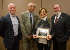 Ibrahim Jammal, founder of UB's urban planning program, was posthumously recognized by ACSP's Global Planning Educators Interest Group for his impact on international planning education. His wife Viviane Jammal (second from right) accepted the award. Standing with Jammal are (from left to right), Daniel Hess, Alfred Price, and Dean Robert Shibley. Photo by Maryanne Schultz