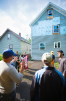 Peter Russell (left) and Ed Steinfeld show students the rear of the house, where the design allows for a lift to be retrofitted to permit aging in place. Photo: Douglas Levere