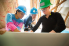 Architecture and planning students work on a Habitat for Humanity home on Buffalo's East Side. Photo: Douglas Levere
