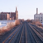 Train tracks running past abandoned factories.