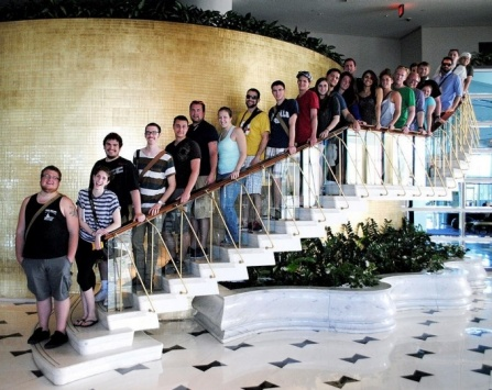 Architectures students pose on a staircase in the Fontainebleau hotel in Miami Beach. The hotel, which opened in 1954, was designed by Morris Lapidus.