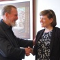 Dean Shibley shakes hand of Molly Ranahan, UB's first PhD in urban and regional planning graduate