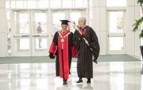 Professor LeCuyer and President Tripathi walk together.