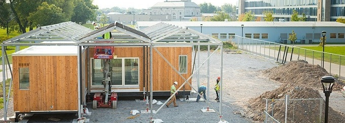 Workers reconstruct the GRoW Home on the South Campus during summer 2017. Photo: Douglas Levere.