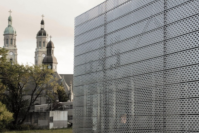 "Romano's design of a perforated, deep-textured metal façade for ""LIGHT/STATION,"" a new facility for Buffalo's Torn Space Theater, was awarded design awards in both the Commercial and Small Project categories by the AIA Buffalo/WNY."