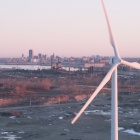 """Water, Wind, and Steel"": a still from the film, of wind turbines on the former site of Bethlehem Steel along Buffalo's Lake Erie shoreline"