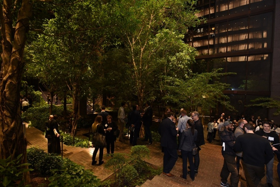 The conversation continues during a reception in the newly restored garden atrium of the Ford Foundation Center for Social Justice. The historic landmark designed by Kevin Roche was recently restored, with its design led by global architecture firm Gensler.
