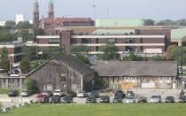 The existing barn with Buffalo State college dorms in the background.
