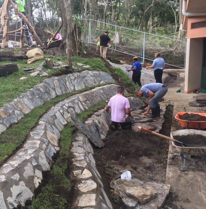 Students work on terraced seating using indigenous stone.