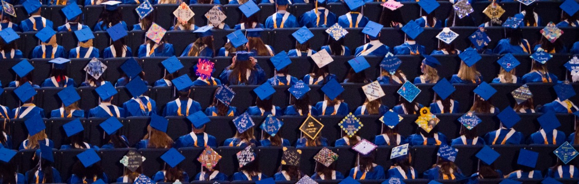 a sea of graduation caps, from above.