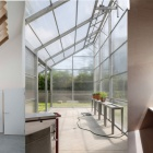 The building has a variety of spaces, large shared, a greenhouse, and small private warm spaces.