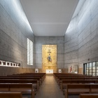modern church with concrete walls, and very high ceilings give a monumentality to the space.