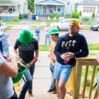 students standing on the porch of the rehabbed house on Summit.