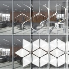 This dynamic facade system creates a star shaped pattern of light screens that can shield large areas of glass.