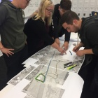 Students explore route options for the Northeast Greenway rails-to-trails studio project with their instructor, Ellen Parker (center).
