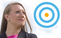 UB BullsEye logo and female student looking right