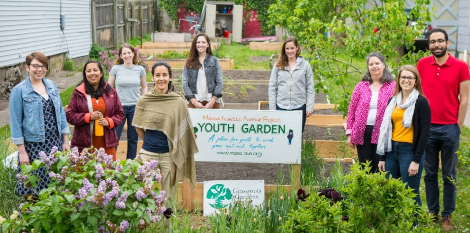Samina Raja and a group of contributors posed in community youth garden project on Buffalo's West Side.