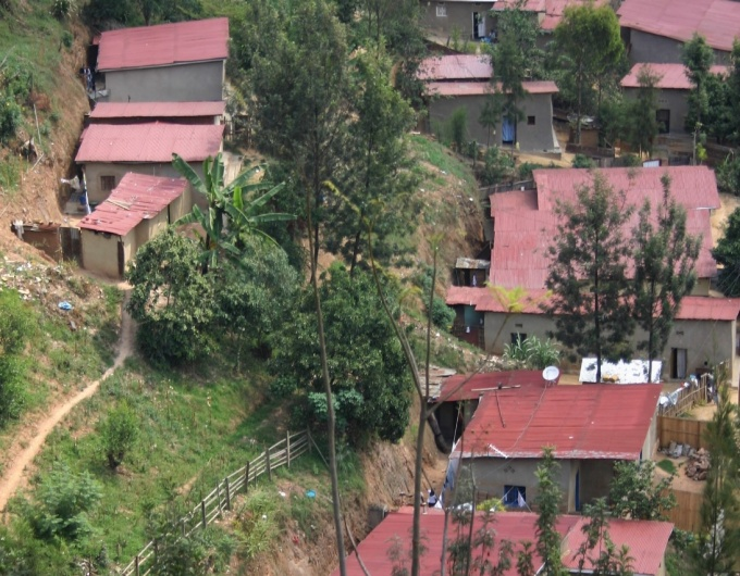 Kigali, Rwanda is a city surrounded by low rise housing in a lush, green environment.